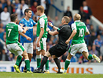 Ref John Beaton races in to intercept Graham Dorrans and Vykintas Slivka