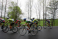 The peloton rides through a rain storm during Stage 5 of the Ford Tour de Georgia. Tom Danielson, of the Discovery Channel Pro Cycling Team, won the 94.5-mile (152.1-km) stage from Blairsville to the top of Brasstown Bald, the highest point in the state.<br />