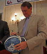 UNC coach Butch Davis signs a helmet after the 9th annual Bill Dooley Pigskin Preview on Thursday, July 21, 2011. Photo by Al Drago.