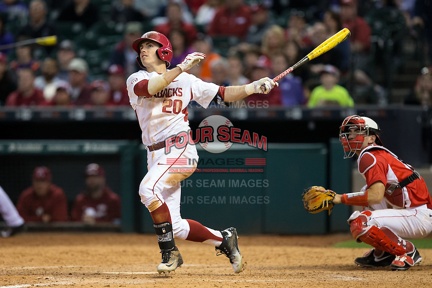 Carson Shaddy (20) of the Arkansas Razorbacks watches the flight of his 2-run home run in the bottom of the 8th inning against the Houston Cougars at Minute Maid Park on February 27, 2016 in Houston, Texas.  The Razorbacks defeated the Cougars 12-3.  (Brian Westerholt/Four Seam Images)