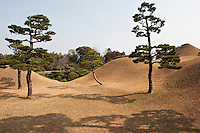 A surreal landscape surrounds the imitation of Mount Fuji in the Suizen-ji garden