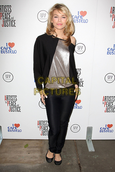 ANNALYNNE McCORD .Artists for Peace and Justice Haiti Benefit held At The Bergamot Station, Santa Monica, California, USA, .28th January 2010..full length black silver shiny off the shoulder top jeans ballet pumps flats .CAP/ADM/KB.©Kevan Brooks/AdMedia/Capital Pictures.