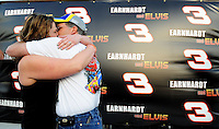 Feb. 27, 2009; Las Vegas, NV, USA; NASCAR Sprint Cup Series fans Heather Landry and Damon Landry kiss after getting married in victory lane following qualifying for the Shelby 427 at Las Vegas Motor Speedway. Mandatory Credit: Mark J. Rebilas-