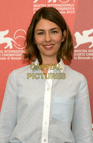 "SOFIA COPPOLA.""Somewhere"" photocall during the .67th Venice International Film Festival,.Venice, Italy, September 3rd, 2010..portrait headshot white shirt smiling director blue striped pinstripe .CAP/PE.©Peter Eden/Capital Pictures."