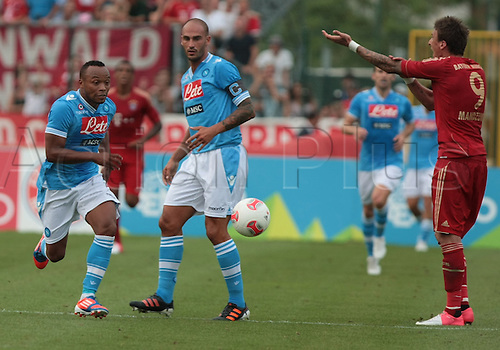 20.07.2012, Arco, Italy. Camilo Zuniga, Paolo Cannavaro in action during the Friendly Football Match FC Bayern vs SSC Napoli 2012. Final score SSC Napoli 3 - 2 FC Bayern Munchen..