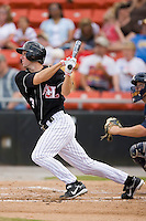 Austin McClune (31) of the Hickory Crawdads follows through on his swing versus the Charleston RiverDogs at L.P. Frans Stadium in Hickory, NC, Sunday, May 4, 2008.
