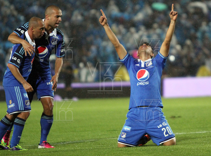 BOGOTA -COLOMBIA. 16-03-2014. Harrison Otalvaro de Millonarios   celebra su gol contra El Itagui  partido por la onceava fecha de La liga Postobon 1 disputado en el estadio Nemesio Camacho El Campin. /   Harrison Otalvaro of Millonarios  celebrates his goal  against Itagui  during the match for the eleenth round of The Postobon one league match at Nemesio Camacho El Campin  Stadium . Photo: VizzorImage/ Felipe Caicedo / Staff