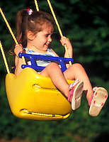 Little girl on a swing.