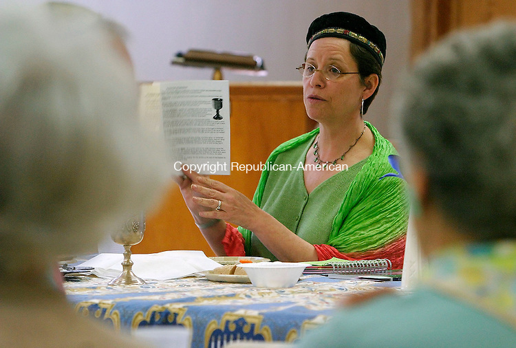 TORRINGTON, CT- 17 APRIL 2005-041705JS01--Connie Smilowitz of West Hartford, leads guests in a model Passover Seder Sunday at the Beth El Synagogue in Torrington. The event was sponsored by the Interfaith Council of Northwest Connecticut --- Jim Shannon Photo--Interfaith Council of Northwest Connecticut; Passover; Seder; Connie Smilowitz, West Hartford are CQ