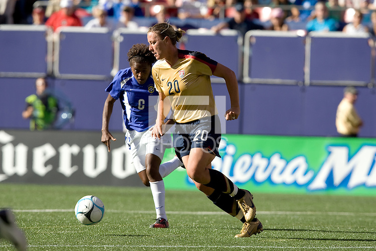 Abby Wambach dribbles ahead of Maicon. USA defeated Brazil 2-0 at Giants Stadium on Sunday, June 23, 2007.
