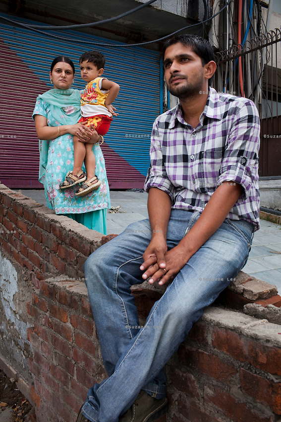 (L-R) 26 year old sailor Third Officer Jaswinder Singh's wife Nirmal Singh (aged 23) and son Abhimanyu (aged 2), and brother Rigan Singh visit Delhi from Haryana..Immediate family members of the 6 Indian sailors, out of 24 international crew members of the M.V. Iceberg 1, held captive by Somali pirates visit the Indian capital of Delhi to hold a press conference in hope of pushing for the release of the hostages. Captured 16 months ago as it was docked at Aden Port, Gulf of Aden, Somalia, MV Iceberg 1 is the longest-held ship by Somali pirates. The Indian sailors are Dheeraj Tiwari, Swapnil Jadhav, Ganesh Mohite, Saji Kumar Purshottam, Santosh Kumar Yadav and Jaswinder Singh. Photo by Suzanne Lee