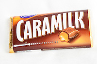 A Cadbury Caramilk over a white background