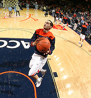 Virginia Cavaliers guard Sammy Zeglinski (13), right, shoots the ball during the game against North Carolina in Charlottesville, Va. North Carolina defeated Virginia 54-51.