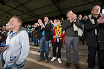 Home supporters, including a boy with a scarf featuring a Scottish saltire flag, applaud the home team's opening goal during the first half at Shielfield Park, during the Scottish League Two fixture between Berwick Rangers and East Stirlingshire. The home club occupied a unique position in Scottish football as they are based in Berwick-upon-Tweed, which lies a few miles inside England. Berwick won the match by 5-0, watched by a crowd of 509.