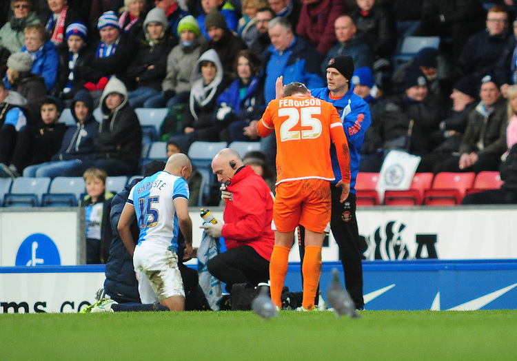 Blackpool's David Ferguson receives treatment from Blackpool's Physiotherapist Phil Horner for a head injury<br /> <br /> Photographer Chris Vaughan/CameraSport<br /> <br /> Football - The Football League Sky Bet Championship - Blackburn Rovers v Blackpool - Saturday 21st February 2015 - Ewood Park - Blackburn<br /> <br /> &copy; CameraSport - 43 Linden Ave. Countesthorpe. Leicester. England. LE8 5PG - Tel: +44 (0) 116 277 4147 - admin@camerasport.com - www.camerasport.com