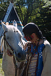 A Native American Indian man with his horse