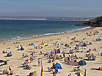 Holidaymakers sunbathing on the golden sands of the beaches around St Ives in Cornwall UK..©shoutpictures.com..john@shoutpictures.com