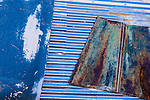 Geometric blue abstract of rusty car parts