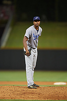 Pensacola Blue Wahoos relief pitcher Victor Payano (20) looks in for the sign during a game against the Birmingham Barons on May 8, 2018 at Regions Field in Birmingham, Alabama.  Birmingham defeated Pensacola 5-2.  (Mike Janes/Four Seam Images)