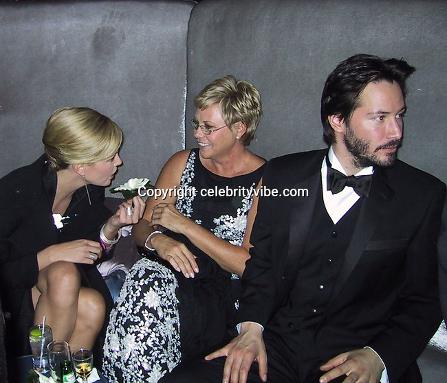 Charlize Theron, Mother and Keanu Reeves.Warner Brothers/InStyle Magazine Post Golden Globe Party .Beverly Hilton Hotel, Los Angeles, CA .Sunday, January 21, 2001.Photo by CelebrityVibe.com..