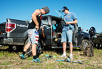 Parker Watkins (cq, left) and Dawson Urrutia (cq) with team The Bone Yard from Arkansas, prepare their bows at the U.S. Open Bowfishing Championship, Saturday, May 3, 2014. <br /> <br /> Photo by Matt Nager
