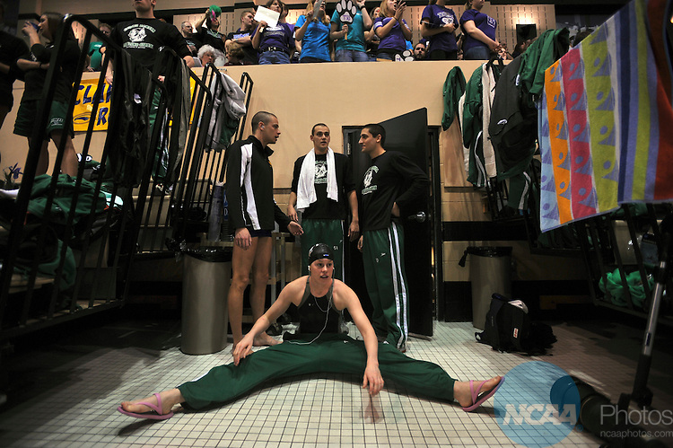 15 MAR 2008:  Caycee Anvik, a junior from University of North Dakota, stretches before competing in the 200 Yard Breaststroke.  She placed twelfth overall with a time of 2:23.37.  John Tully/NCAA Photos