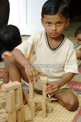 Young child in one of Chennai's many suburban slum playschools; India, Tamil Nadu, Chennai (Madras), 2005. The kindergarten is mostly supported and financed by international volunteers. No releases available.