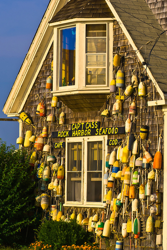 A display of buoys on the outside of Captain Cass' Rock Harbor Seafood Restaurant, Rock Harbor, Orleans, Cape Cod, Massachusetts, USA