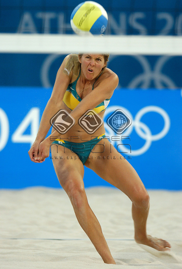 Natalie Cook (AUS) plays on with injuried shoulder<br /> Beach Volleyball - Bronze medal/AUS vs USA<br /> Summer Olympics - Athens, Greece 2004<br /> Day 12, Wednesday 25th August 2004.<br /> &copy; Sport the library/Jeff Crow