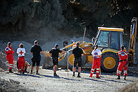 Pictured: Forensic archaeologists and Hellenic Red Cross volunteers, assisted by a digger, go through soil at the site where Ben Needham disappeared from in Kos, Greece. Friday 14 October 2016<br />