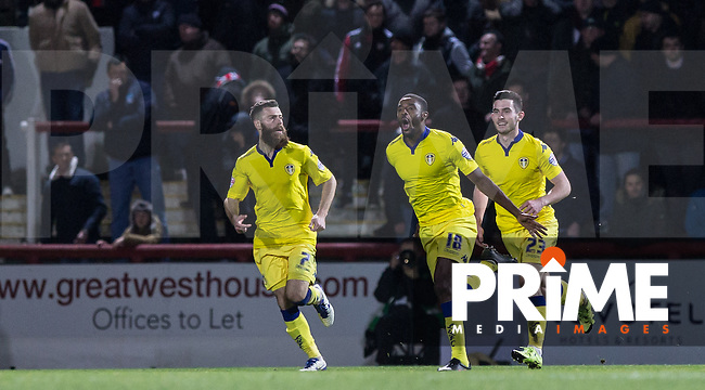 Mustapha Carayol (centre) of Leeds United turns to celebrate his goal making it 1-1 during the Sky Bet Championship match between Brentford and Leeds United at Griffin Park, London, England on 26 January 2016. Photo by Andy Rowland / PRiME Media Images.