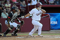 Designated hitter Max Schrock (22) of the South Carolina Gamecocks bats in an NCAA Division I Baseball Regional Tournament game against the Maryland Terrapins on Sunday, June 1, 2014, at Carolina Stadium in Columbia, South Carolina. The Maryland catcher is Kevin Martir. Maryland won, 10-1, to win the tournament. (Tom Priddy/Four Seam Images)