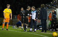 Referee Brendan Malone walks over to talk to Wycombe Wanderers Assistant Manager Richard Dobson during the Sky Bet League 2 rearranged match between Bristol Rovers and Wycombe Wanderers at the Memorial Stadium, Bristol, England on 1 December 2015. Photo by Andy Rowland.