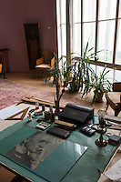 Moscow, Russia, 25/04/2013..Living room and work space inside the Melnikov House [1927-1929], the most famous construction by Soviet avant-garde architect Konstantin Melnikov, in central Moscow. The house, which is slowly collapsing, is the subject of a complex dispute between the architect's grand-daughter Ekaterina, who lives there and wants to turn it into a museum, her sister Elena, and businessman Sergei Gordeev.