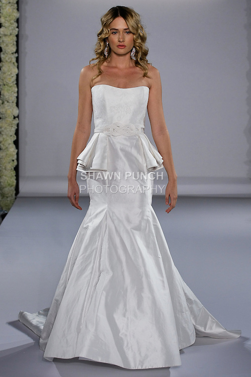 Model walks runway in a Princesse wedding dress from the Jorge Manuel Bridal collection, for the Couture Runway Show, during New York Bridal Fashion Week at The Hilton Hotel, October 13, 2012.