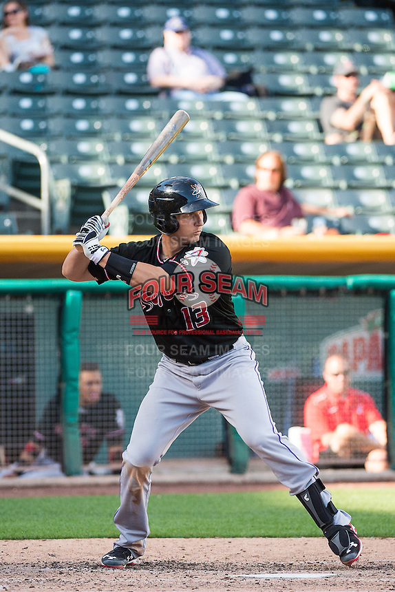 Dustin Garneau (13) of the Albuquerque Isotopes at bat against the Salt Lake Bees in Pacific Coast League action at Smith's Ballpark on June 8, 2015 in Salt Lake City, Utah.  (Stephen Smith/Four Seam Images)