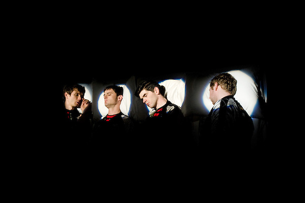"""July 29, 2005. New York , NY..(left to right)  Alex Kapranos, Nick McCarthy, Paul Thomson and Bob Hardy wait for the filming of a dream sequence to begin..Behind the scenes with Franz Ferdinand during the  filming of the music video """" Do You Want To"""" in  Manhattan."""