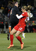 BOYDS, MARYLAND - April 06, 2013:  Stephanie Ochs (22) of The Washington Spirit is beaten to the ball by Churchill O'Connell (1) of the University of Virginia women's soccer team in a NWSL (National Women's Soccer League) pre season exhibition game at Maryland Soccerplex in Boyds, Maryland on April 06. Virginia won 6-3.