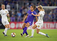 Orlando, FL - Saturday March 24, 2018: Orlando Pride defender Toni Pressley (3) plays the ball away from Utah Royals defender Katie Bowen (6) during a regular season National Women's Soccer League (NWSL) match between the Orlando Pride and the Utah Royals FC at Orlando City Stadium. The game ended in a 1-1 draw.