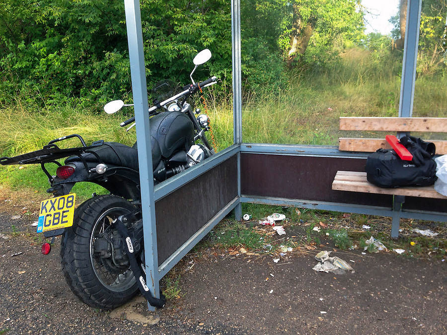 Ozolaine, Latvia, 19/07/2013.<br /> Moto Guzzi Bellagio broken down and chained to bus stop in village of Ozolaine.