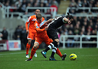 Pictured L-R: Mark Gower of Swansea challenging Jonas Gutierrez of Newcastle. Saturday 17 December 2011<br />