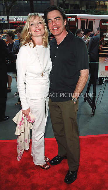 Peter Gallagher and his wife arrive at the world premiere of Mr. Deeds in New York. June 18, 2002. Please byline: Alecsey Boldeskul/NY Photo Press.   ..*PAY-PER-USE*      ....NY Photo Press:  ..phone (646) 267-6913;   ..e-mail: info@nyphotopress.com
