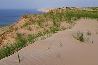 Shifting sands and grasses etch the surface of Grand Sable Dunes in Pictured Rocks National Lakeshore near Grand Marais Michigan.