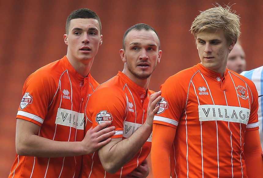 Blackpool's Lloyd Jones, Tom Aldred and Brad Potts<br /> <br /> Photographer Mick Walker/CameraSport<br /> <br /> Football - The Football League Sky Bet League One - Blackpool v Coventry City - Saturday 12th March 2016 - Bloomfield Road - Blackpool   <br /> <br /> &copy; CameraSport - 43 Linden Ave. Countesthorpe. Leicester. England. LE8 5PG - Tel: +44 (0) 116 277 4147 - admin@camerasport.com - www.camerasport.com