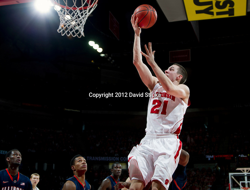 Wisconsin Badgers guard Josh Gasser (21) scores during a Big Ten Conference NCAA college basketball game against the Illinois Fighting Illini on Sunday, March 4, 2012 in Madison, Wisconsin. The Badgers won 70-56. (Photo by David Stluka)