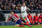 Luka Modric (r) of Real Madrid competes for the ball with Lucas Hernandez of Atletico de Madrid during the La Liga 2017-18 match between Atletico de Madrid and Real Madrid at Wanda Metropolitano  on November 18 2017 in Madrid, Spain. Photo by Diego Gonzalez / Power Sport Images