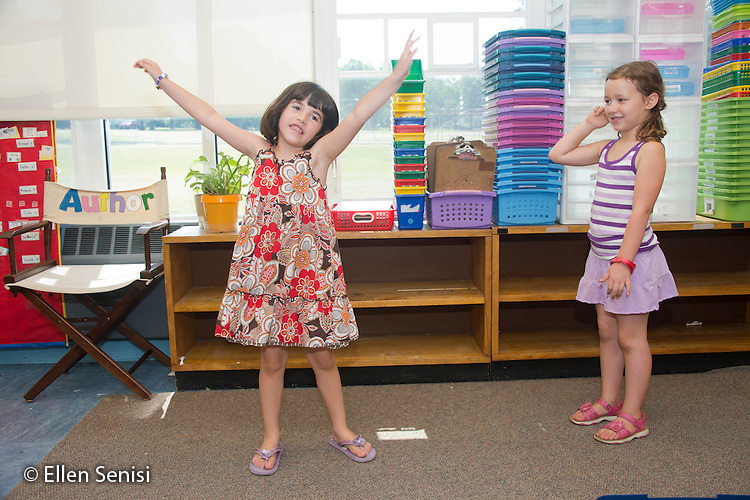 MR / Schenectady, NY. Zoller Elementary School (urban public school). Kindergarten classroom. Two students (girls, 5) practice their skit for school play (drama program). MR: Coh2, Cas12. ID: AM-gKw. © Ellen B. Senisi.