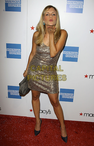 SALLY PRESSMAN. 27th Annual Macy's Passport Fashion Show Benefit - Arrivals held At Barker Hangar, Santa Monica, California, USA..September 24th, 2009.full length gold one shoulder dress jewel encrusted embellished sequins sequined black clutch bag hand blowing kiss shoes .CAP/ADM/KB.©Kevan Brooks/AdMedia/Capital Pictures.