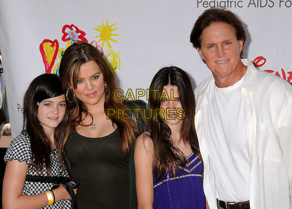 "KYLIE JENNER, KHLOE KARDASHIAN, KENDALL JENNER & BRUCE JENNER .""A Time For Heroes"" Celebrity Carnival Benefit for the Elizabeth Glaser Pediatric AIDS Foundation at the Wadsworth Fairgrounds, Los Angeles, California, USA..June 8th, 2008.half length white shirt black purple .CAP/ADM/BP.©Byron Purvis/AdMedia/Capital Pictures."