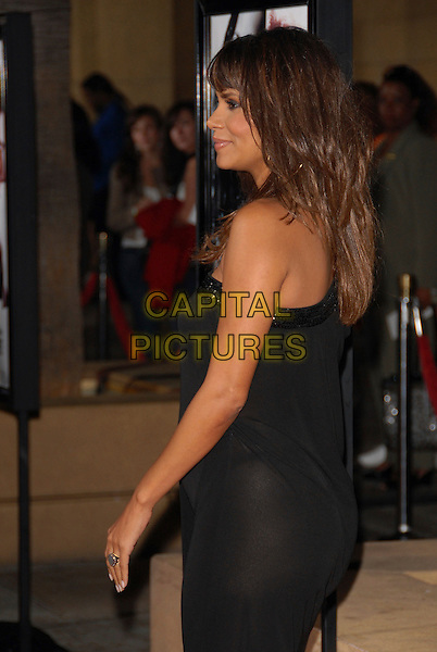 HALLE BERRY.attends The Dreamworks L.A. Premiere of Things We Lost in The Fire held at The Egyptian Theatre in Hollywood, California, USA, October 15 2007..half length black one shoulder strap dress side back behind  pregnant.CAP/DVS.©Debbie VanStory/Capital Pictures